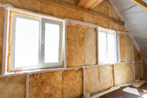 36493039 - inside wall heat isolation with mineral wool in wooden house,  building under construction